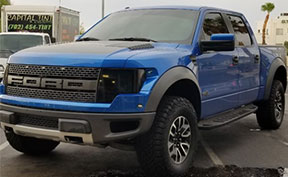 Blue Ford Raptor With Smoked Out Lights